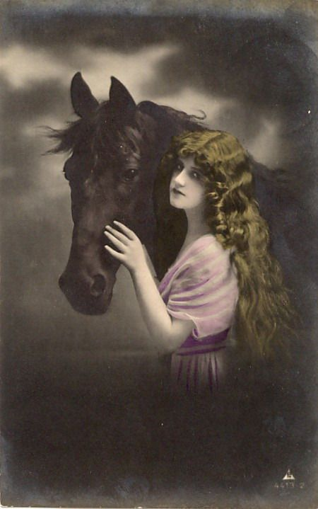 Vintage lady in a pink dress with black beauty horse.